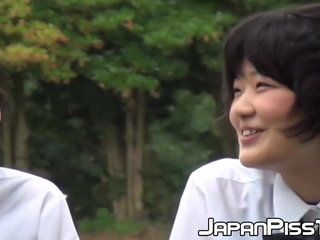 Cute Japanse schoolgirl with pigtails pees in the wind